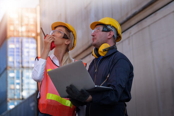vecteezy_two-technicians-work-together-outside-industrial-plant_1226891